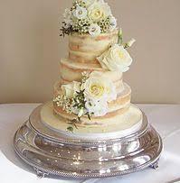 semi wedding cake with edible log stand by mirtha u0027s p arty