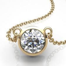 set diamond 14kt yellow gold bezel set solitaire diamond pendant union