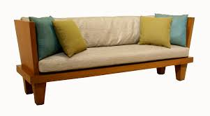 pampering small wooden benches with white pad and bright cushions