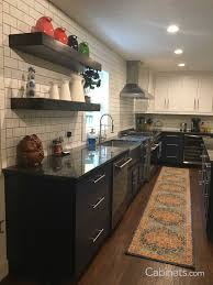 satin nickel white kitchen love everything about this trends we re loving blue hue painted cabinets cabinets com