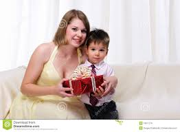 mom giving a gift to his son royalty free stock image image