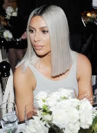 khloé kardashian debuts short lob kim kardashian shows off shorter hair with matching dress people com