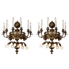magnificent antique twelve light sconce pair with fleur de lis