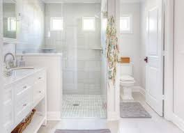 simple bathroom with separate shower and bathtub on small home
