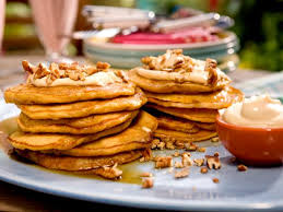 carrot cake pancakes with maple cream cheese drizzle and toasted