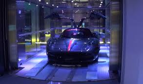 porsche design tower car elevator watch how supercars go up elevator to 40 million condo