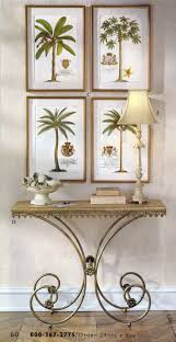 174 best tropical decor for my beach house images on pinterest set of 4 ehret palm tree prints hanging over a console table all from the ballard designs catalog