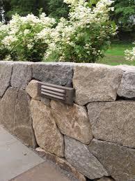 retaining wall lights under cap nilsen landscape design ideas for lighting a landscape wall