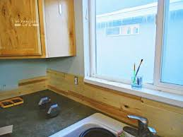 wood backsplash kitchen how to install a wood plank backsplash my fabuless