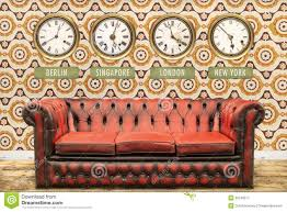 Chesterfield Sofa Vintage by Retro Chesterfield Sofa With World Time Clocks On A Wall Royalty