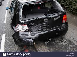 black volkswagen golf black vw golf totally written off rear end damage stock photo