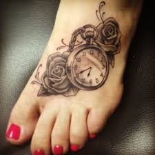 grey rose flower and clock tattoo on left foot