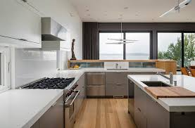 metal kitchen island modern metal kitchen cabinets with white caesarstone countertop