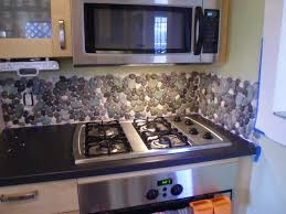 creative design river rock backsplash for kitchen decoration
