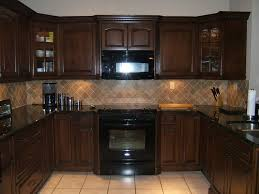 cherry cabinets with black granite countertops marble kitchen