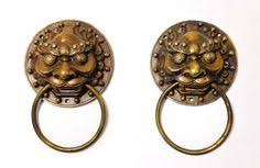 foo dog door knocker foo dog guardian lion thundering through thousands of years