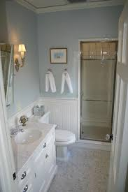 chic cottage beachy bathroom design with blue walls paint color