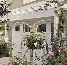 like the detail of the arch above the garage doors the arbor is