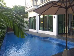 photos hgtv swimming pool and white patio clipgoo modern tropical