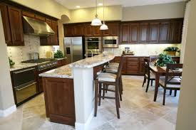 cheerful tiny kitchen with pure white island with marble top also
