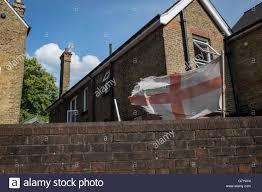 Flies In Backyard A Ragged English Flag Flies Forlornly Over A Backyard As England