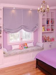 the built in window seat and lilac fabric tie in with the walls
