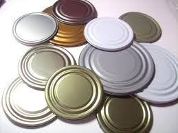 how to make jewelry or decorations out of tin can lids snapguide