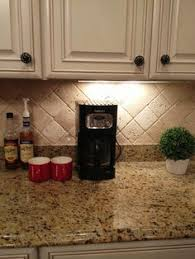 Granite Countertops And Kitchen Tile Backsplashes 3 by Look How The Glass Tile Backsplash Contains All Of The Colors From