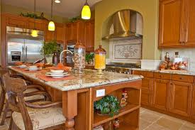 399 kitchen island ideas for 2017 warm wood tones unify this kitchen featuring large island with ample seating area built