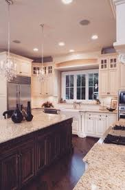 stone countertops dark wood kitchen cabinets lighting flooring