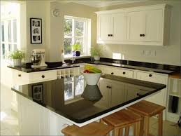 Replacing Kitchen Faucet In Granite by Granite Countertop White Kitchen Countertops With Brown Cabinets
