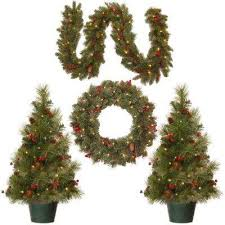 brown christmas tree potted artificial christmas trees christmas trees the home depot