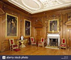 the fireplace in the saloon at belton house showing paintings