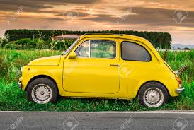 vintage yellow color small vintage italian car fiat abarth yellow color stock photo