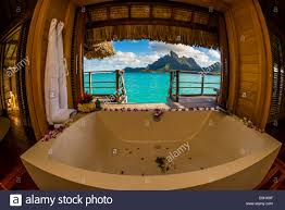 view from a bathtub in an overwater bungalow mt otemanu in stock