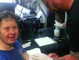 tattoo artist refuses to tattoo down syndrome woman what he does