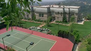 day high down backyard foreground swimming pool tennis court large