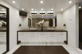 white bathroom with textured tiles shower zone and central bench