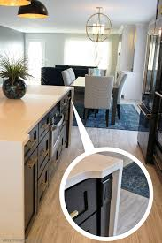 kitchen island outlet ideas black painted kitchen island with waterfalling hanstone quartz