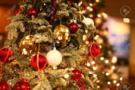 christmas tree closeup with beautiful and colorful ornaments stock