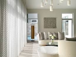double height curved sectional gray area rug columns high ceiling