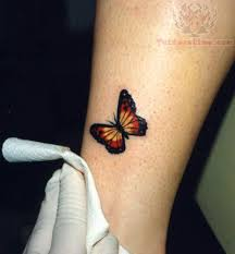 beautiful small butterfly tattoo