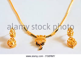 gold earrings for marriage concept gold black necklace mangalsutra symbol