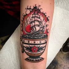olio teacup tattoo by pjandersontattoos from gold club electric