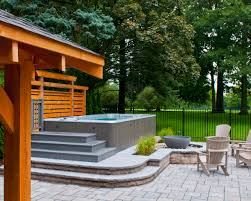 hydropool self cleaning swim spa installed on stone deck swim