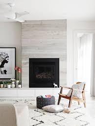 living room pale oak timber panelled feature wall fireplace