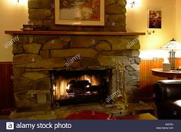 cozy fireplace and guest lounge in the heron inn bed and breakfast