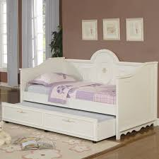 white wooden daybed with storage and purple bed cover on the floor