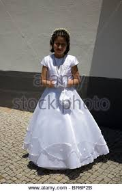 1st holy communion dresses girl in holy communion dress holding a crucifix in 1918