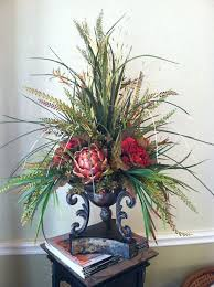 adorable designer artificial flowers and garden flowers in glass